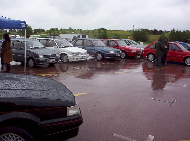 Six MG 'M' and two MG Zed cars meet in the rain at Gaydon