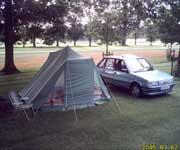 MG Maestro 1600 parked next to a tent full of spares